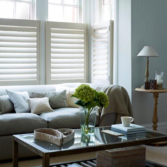 Cafe style shutters in living room by Shutterly Fabulous